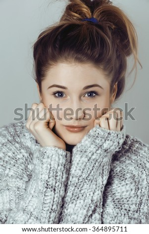 beauty young real woman in sweater at winter warmed up, cheerful smiling closeup, cute girl - stock photo