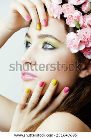 Beauty young real woman with pink flowers and make up closeup, spa - stock photo