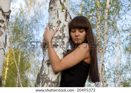 Beauty young sexy girl hugging the birch - stock photo