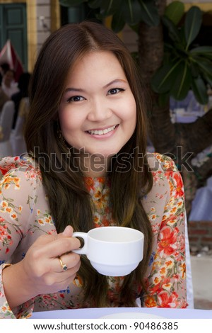 Beauty young smiling hold a cup of coffee - stock photo