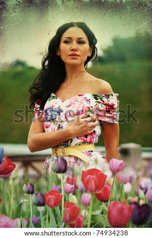 beauty young woman in dress with tulips - stock photo
