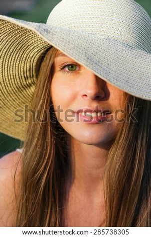 Beauty young woman in hat. Close up shot.