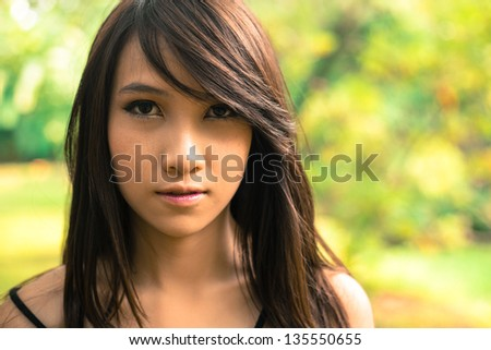 Beauty young woman  in nature background - stock photo