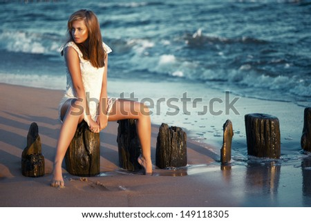Beauty young woman on the beach  - stock photo