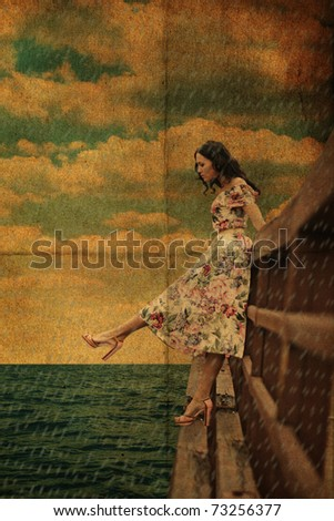 beauty young woman on the bridge in the rain - stock photo
