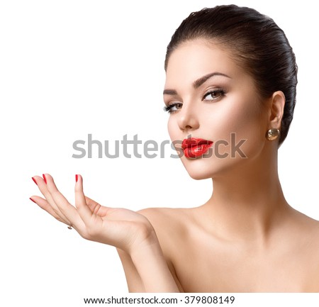 Beauty young woman portrait. Beautiful Fashion sexy Girl showing copy space on the open hand. Gestures for advertisement. Spa Girl showing copyspace for text. Proposing a product. Skin Care, Make up - stock photo