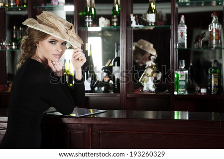 Beauty young woman portrait in a luxury bar. - stock photo
