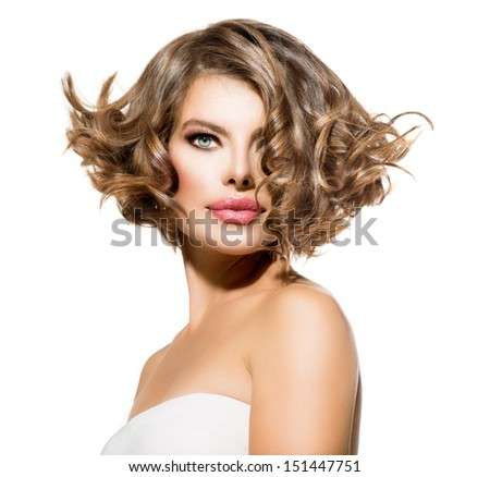 Beauty Young Woman Portrait over White Background. Beautiful Model Girl Face. Short Curly Hair, Fresh Clean Skin and Green Eyes. Hairstyle. Haircut - stock photo