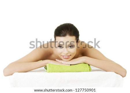 Beauty young woman relaxing in spa. Isolated on white. - stock photo