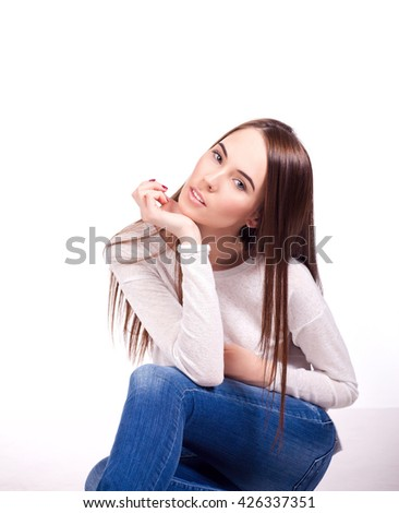 Beauty young woman sitting down on the floor