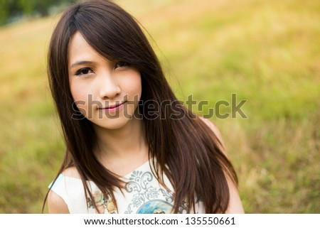 Beauty young woman smiling in the park