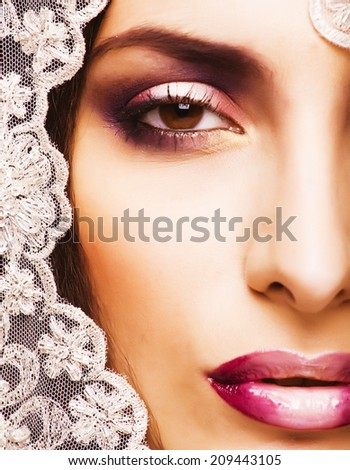 beauty young woman throw white lace close up - stock photo