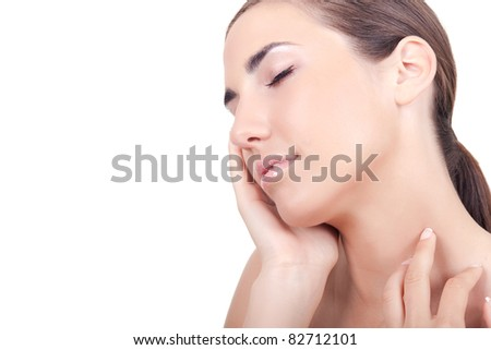 beauty young  woman touching her face with hands, isolated on white background - stock photo