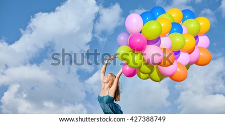 Beauty young woman with balloons