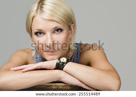 beauty young woman with beautiful blue-eyed - stock photo