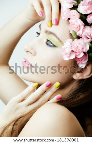Beauty young woman with flowers and make up close up - stock photo