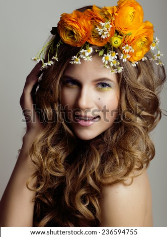 Beauty young woman with flowers and make up close up, real spring beauty girl curly hair - stock photo
