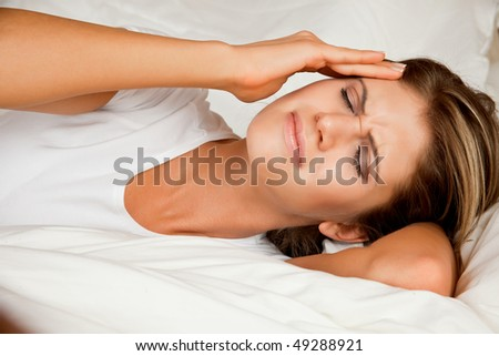 Beauty, young woman with headache