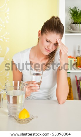 Beauty, young woman with headache - stock photo