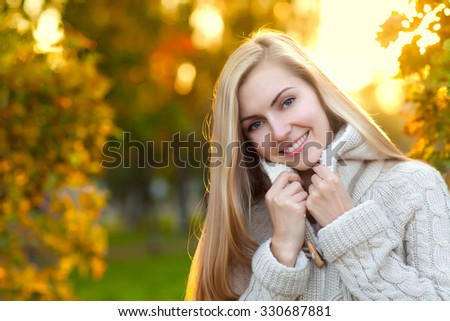 Beauty young woman with long blonde hair joy in the park