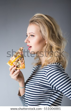 beauty young woman with pizza on gray background