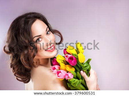 Beauty young woman with tulips