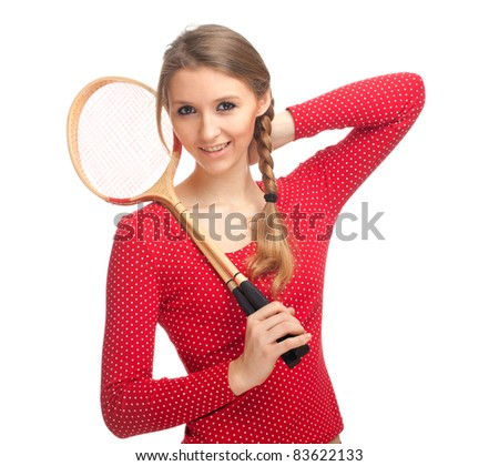 beauty young woman with wooden badminton rackets - stock photo