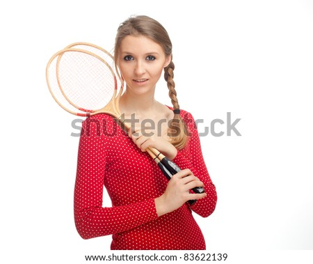 beauty young woman with wooden badminton rackets