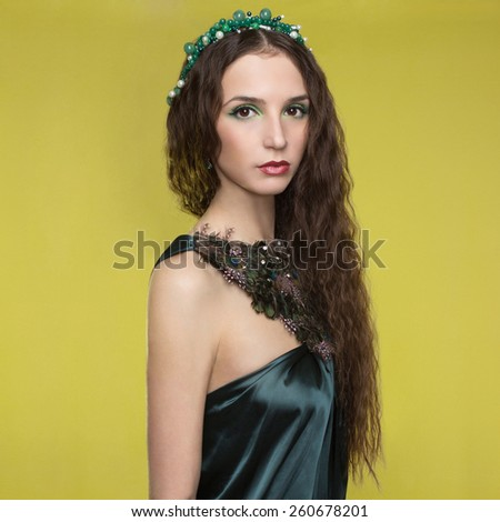 beautyful brunette young woman with accessories.fashionable girl.jewelery.color background - stock photo