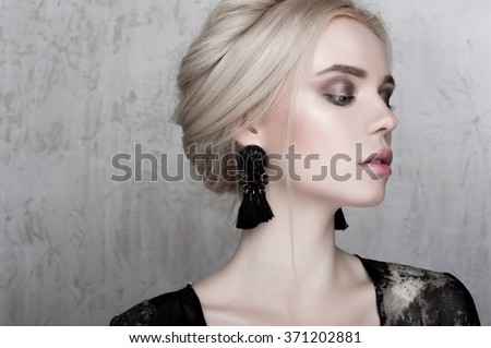 Beautyful face. Beautiful european model. Glamour portrait of l woman model with fresh daily makeup and romantichairstyle. Fashion shiny highlighter on skin, sexy gloss lips make-up and dark eyebrows - stock photo