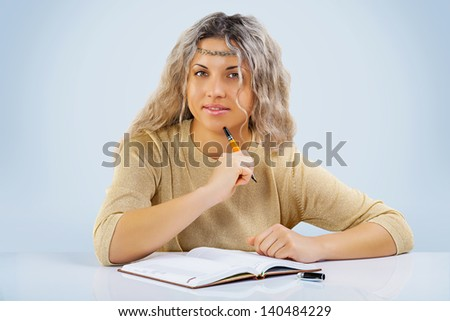 beautyful female at the table with notepad