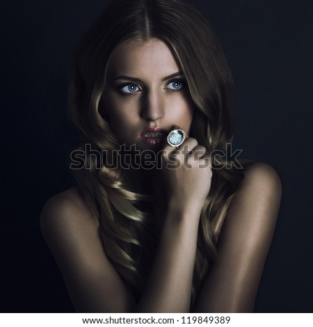 beautyful young woman portrait. jewerly and diamonds - stock photo