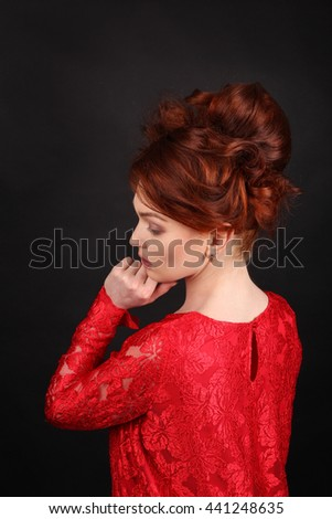 Beauutiful young woman with red hair. Latin woman with makeup, hairstyle. Beautiful woman with long black curly hair, natural make-up over black background. Wavy Red Hair. Fashion Girl Portrait. - stock photo