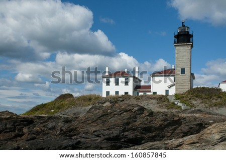 Beavertail Lighthouse is Connecticut's second oldest lighthouse, guiding mariners around its rocky shoreline. - stock photo