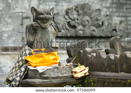 Beckoning cat at the entrance to hindu temple in Bali, Indonesia - stock photo