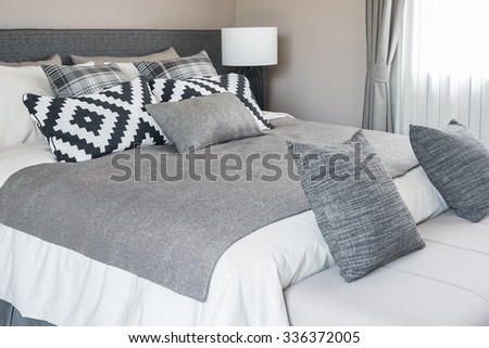 bed and pillows in modern bedroom, black and white color tone - stock photo