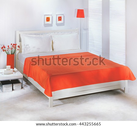 Bed and plain orange bedspread