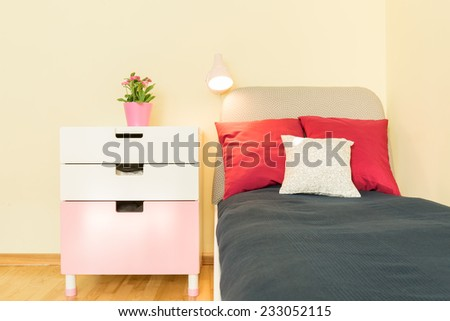 Bed and shelf in beauty girl's room - stock photo