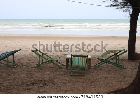Bed beach and chairs without umbrella in summer at Rayong beach Thailand