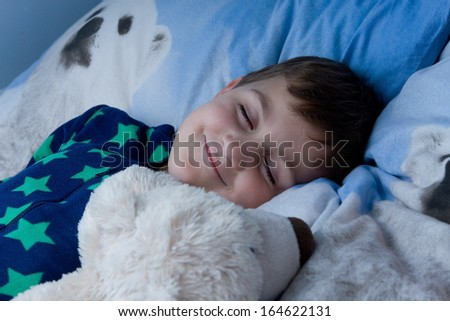 bed, bedtime, boy, cheeky, child, childhood, children, cute, happy, kid, lamp, light, little, night, sleep, sleeptime, smile, smiling, sweet - stock photo