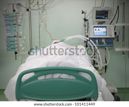 bed ICU with the patient. photo - stock photo