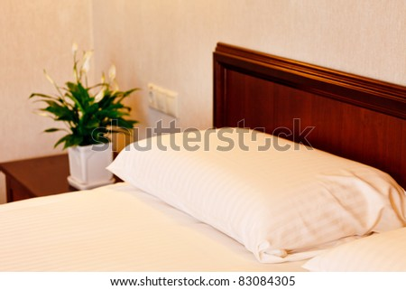 bed in a luxury hotel room