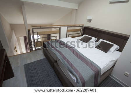 bed in duplex apartment - stock photo