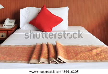 bed in the hotel room - stock photo