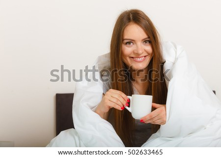 Bed relax sleep dream breakfast concept. Cheerful girl drinking coffee. Young lady having morning cup of hot beverage in bed.