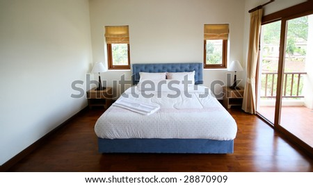 Bed room interior of a modern house - home interiors. - stock photo