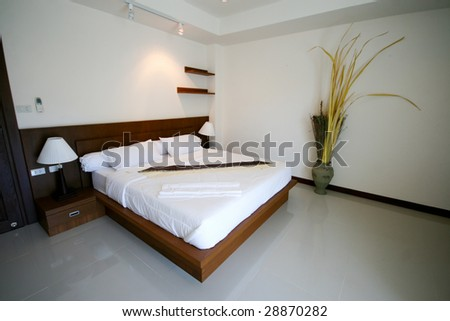Bed room of a modern house - home interiors. - stock photo