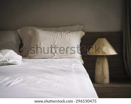 Bed sheet Mattress and pillows in bedroom with Lamp Natural style home interior decoration - stock photo