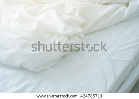 Bed sheet with wrinkle. - stock photo