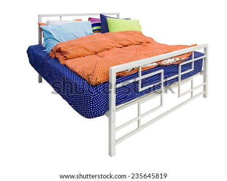 Bed with colorful duvet and cushions isolated on white background - stock photo